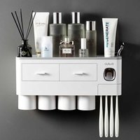 Titular da escova de dentes Montagem de parede Adsorção magnética Invertido DentyPaste Dispenser Maquiagem Armazenamento de Maquiagem para acessórios de banheiro Set 713 v2