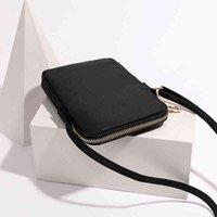 Diseñador de lujo de mini paquete de alta calidad Teléfono móvil Tendencia femenina Sección vertical Sección salvaje Oxford Doek Messenger Pequeña tarea cuadrada