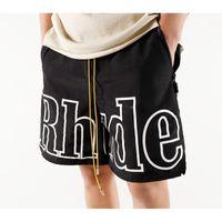 Designer Rhude Men's Shorts Loose Carta Reflexiva Capris Hip Hop Casal Casal Mens Calças Esportivas Mulheres Moda Rua Branca Roupa