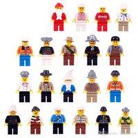 20pcs Lot Niños Bloques de construcción Ladrillos Mini Dibujos animados Multi Roles Figuras Doll Toys Pequeños partículas Puzzle Modelo de juguete