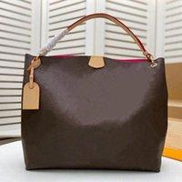 حقيبة رشيقة حقيبة مم المتطرفة الكلاسيكية محفظة توتس 35 سنتيمتر جلد طبيعي ليونة شقة حزام سيدة حقيبة الكتف M43701
