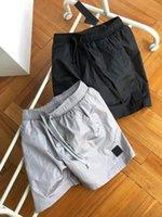 Mens Shorts Track Calças de verão Beach Bottoms com Bronze Side Bolso Camisola TRUSE UNISEX Outwears Street Calço Calço Cordilheira Ajuste Tamanho S-XL