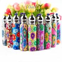 50 pçs / lote lindo rolo de 10ml em garrafas polímero de argila de polímero frasco de óleo essencial frasco de perfume vazio com bola de vidro