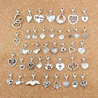 117pcs / lots Argent Antique Silver Coeur Mixte Flottant Homester Clasps Charme Perles de charme pour bijoux Faire fabrication de bracelet Collier constatations