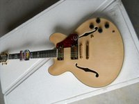 F Semi-hollow electric guitar, wood color body, gold accessories, red tortoiseshell guard