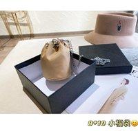 Carteras de alta calidad Mujeres hombres monedero bolso de mano clásico titular de llavero llavero con caja de polvo