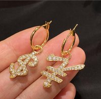 2021 USD coin symbol Dangle & Chandelier trendy golden rich full diamond zircon earrings high quality and fast delivery