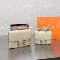 Femmes de luxe Design Classic Big Brand Kangkang Sac Cowhide Sacs de Vol Sacs Haut Workmanship Sans épaule Paquet Métal Boucle en métal Délicat maquillage sac à main