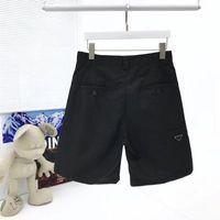 21SS Европа Америка короткие брюки дизайнерские повседневные брюки высокого качества импортированный нейлоновый материал удобный перевернутый треугольник металлический значок дизайн лето шорты