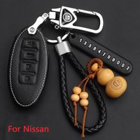 Genuine Leather car key cover For Nissan sunny LIVINA X-Trail Qashqai Sylphy Tiida Teana geniss 2014 keys case with Car Rings