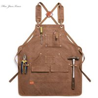 Durable goods. Heavy-duty unisex canvas work apron with tool bag and cross straps with adjustable wood coating