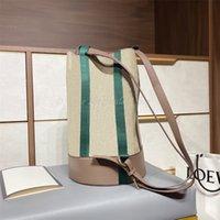 Famous de lujo diseñador bolso de cucharón colorido raya marrón cuero cuero conflictivo color rayado cinta interna cremallera moda mochila estilo