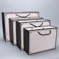 5 unids al por mayor recubierto blanco cartulina papel bolsa de papel bolsa de regalo personalizado papel bolso de papel bolso de almacenamiento de regalos 210729