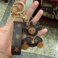 İnek Anahtar Zincirleri Aksesuarları Kahverengi Çiçek Teddy Bear PU Deri Araba Anahtarlıklar Yüzükler Takı Kadın Erkek Moda Hayvan Çanta Charms Kolye Hediyeler