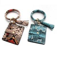 31 Styles Bracelet Porte-clés Sac de cartes avec glands Leopard Sunflower PU en cuir PU Sac de poignet Pandent Touche Décorer Mode LLA701