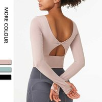 Tracels Stampo Cup Yoga Top Autbiti con reggiseno Nude Sports T-shirt in esecuzione Fitns Hollow Out Back Gym Ploth Donne Manica lunga