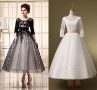 Tea length wedding dress wholesale gorgeous tea length lace free shipping 2015 cheap a line wedding dresses ivory black half sleeve lace up tea length applique lace scoop in stock sheer bridal gowns junglespirit Image collections