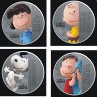 40 unids / lote (10 set), la película de cacahuetes de Hollywood con dibujos animados de Snoopy Lucy Linus Charlie Brown plateado de plata de souvenirs de regalo de Navidad