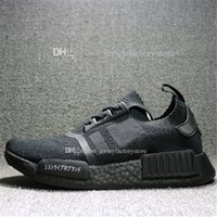 NMD R1 Japan Pack in Triple Black and Triple White Primeknit...
