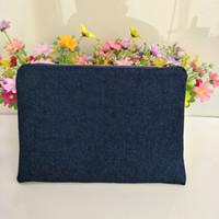 borsa trucco spessa e resistente al 100% in cotone denim blu marino con la vera rivestimento rosso navy-oro zip pouch denim zip