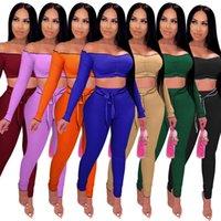 여성의 두 조각 가을과 겨울 여성의 유럽과 미국의 여성용 핏 스트라이프 어깨 긴 소매 허리없는 짧은 상위 Fashi