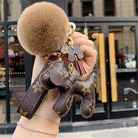 أزياء ماركة الكلب مفتاح سلسلة الكرة الحلي الناعمة الفراء سلاسل الذهب جميل أفخم سيارة كيرينغ النساء مفاتيح حلقات الكلاسيكية ll kchain