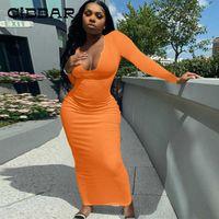 Cibbar 단단한 뜨개질 Maxi 드레스 여성 캐주얼 기본 긴 소매 섹시한 낮은 가슴 바디 콘 드레스 여성 간단한 스트리트웨어 스커트 Q0707