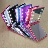 Iluminado LED compacto maquillaje espejos mini portátil plegable dama viajes cosméticos maquillaje de bolsillo espejo iluminación con 8 luces leds para mujeres niñas