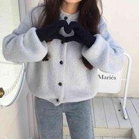 Women's Knits & Tees Suéter feminino largo com botões o, decote redondo e manga bufante H76I