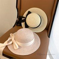 Hepburn Style Children Straw Grass Sun Sombreros Niños Cinta Correa Amplio Brim Panamá Cap Chicas Playa Viajes Sunhat Visor AA7280