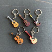 Keychains Creative Mini Musical Instrument Keychain Cute Silicone Guitar Piano Saxophone Key Chain Backpack Car Ornament Musician Jewelry