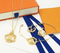 Europa América estilo Joyería Sets Lady Women Gold-Color Metal Hollow Out V Inicials Pendientes de Pendientes Collar de jardín Conjuntos de alta calidad