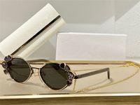 Gafas de sol para las mujeres Estilo de verano Anti-Ultraviolet Shine Retro Oval Marco de metal Diamante Cadena de diamante Caja aleatoria