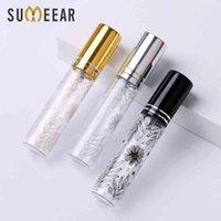 100 pcs / lot 10 ml bouteille de parfum de verre de fleur portable avec atomiseur Mini bouteilles rechargeables cosmétiques vides