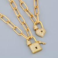 La collana del lucchetto della catena lunga dell'oro dell'oro della FLLA per le donne della serratura del cuore di cristallo ciondolo cubico dei monili del punk di zirconia dei monili dei monili del punk nker60