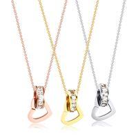 Collier pendentif Collier en acier titane coréen, chaîne de la clavicule féminine, pendentif en plaqué or véritable, accessoires nettes, double anneaux avec rouge i