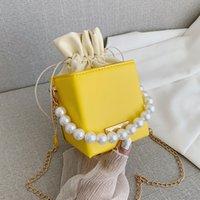 Kleine Damen Handtaschen Perle Kette Top-Griff Eimer Tasche Leder Candy Farbe Geldbörse Branded Crossbody Umhängetasche Für Frauen Verkauf