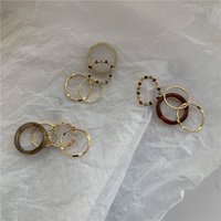 Four piece set of Korean cool wind rice bead index finger ring, acrylic resin crystal beaded joint ring