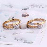 Nuovo Arrivo Luxury Fashion Lady Brass Diamante Zircone rosso / Green Eyes Singolo avvolgente serpente serpente 18K placcato oro braccialetto braccialetto braccialetto