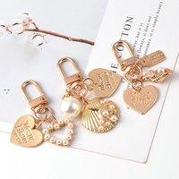 키 체인 귀여운 진주 껍질 파티 호의 펜던트 금속 보석 크리 에이 티브 작은 선물 Airpods 펜던트 개인 포장 OWE9908