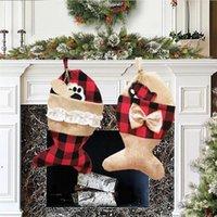 Lindo perro hueso de la navidad de la navidad arpillera de la arpeta de los pasos de la tela escocesa de los peces con la chimenea de la chimenea medias con el regalo del partido del festival de Bowknot DWF9195