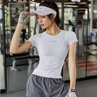 Тренировка Top Womens Tight Быстрые сушильные Упражнения с короткими рукавами Футболка Slim Fit Hit Дышащие бегущие тренировки Yoga Футболка Футболка Футбол Джерси