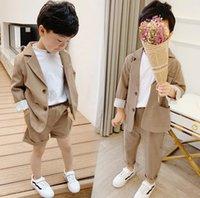 Conjuntos de ropa para niños niños solapa manga larga blazers Outwear + Pantalones de bolsillo doble 2pcs Trajes de rendimiento para niños Ropa de niño A6895