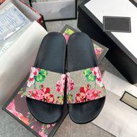 Мужские дизайнеры Slides Womens Sandals Fashion Luxurys Цветочные тапочки Кожаные резиновые Квартиры Сандалии Летние Бич Обувь Мощные Шеферические Шеферические Шеферические Шеферические Назлы Назлоки 36-48