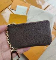 con bolsas de polvo y teclas de caja POCHETE POCHETTER CLES DESIGNADORES Moda Bolso de moda Mujeres Hombre de la tarjeta de crédito Monedero Monedero Lujos Bolsa de billetera