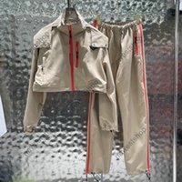 2021 femmes designeurs de luxe Suivi de la veste de travail occasionnel Mens Pantalon Pantalons imprimé TrackSuit Streetwear Femmes Orange Zipper Stripe Sport costume