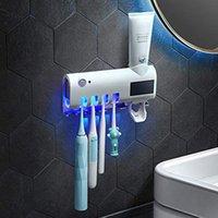 فرشاة الأسنان المطهر القابلة لإعادة الشحن الطاقة الشمسية الأشعة فوق البنفسجية تطهير الحائط حامل الهاتف