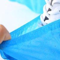 Couvertures de chaussures jetables Couvre-chaussures imperméables non glissière couverture de pied ménage non tissé pour la construction de tapis intérieur de tapis de travail FWD8565