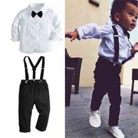 Enfants Enfants Boys Black Bow Cravate Suit Stocker Pantalon Noir et Chemise Blanche 2 Pièce Vêtements Set Formel Robe Banquet Doux Retour à la fête de l'école L729R5T