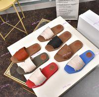 2021 Zapatillas para niños de alta calidad Moda Lienzo Plana Slipper Classic Black Blanco Carta Impresión Cruz Sandalias